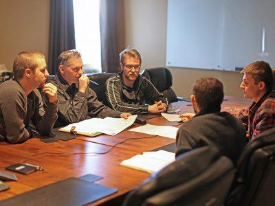 HARD-LINE team members meeting in the boardroom