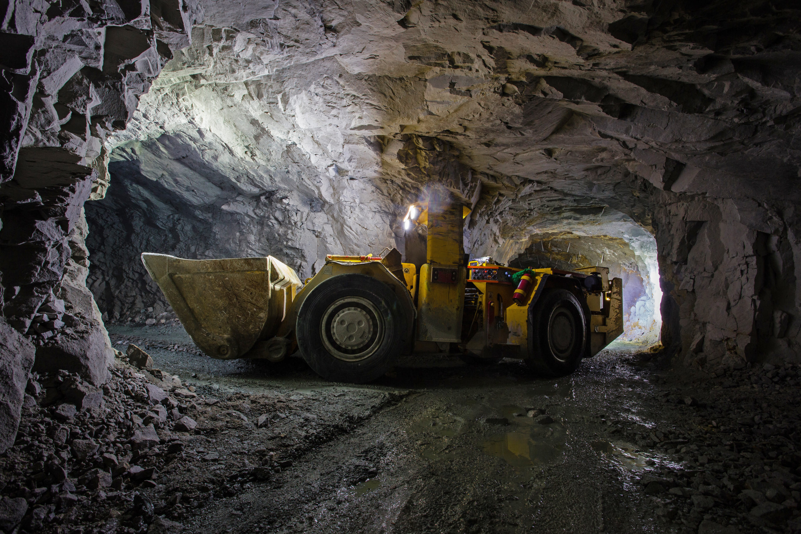 Underground gold ore mine shaft tunnel gallery passage with load