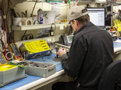Production Employee building an RRC Box