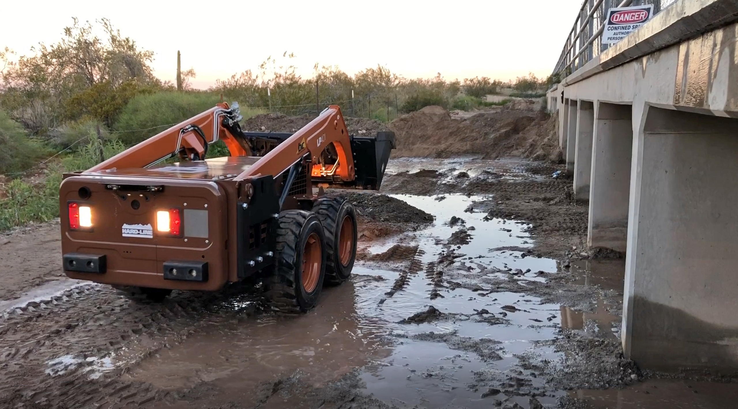 LP401 removing dirt from culverts