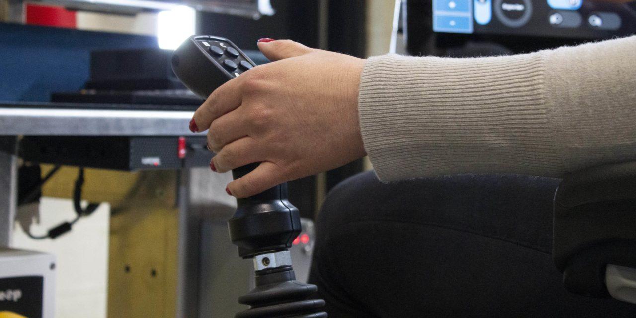 Operator's hand on a TeleOp Joystick