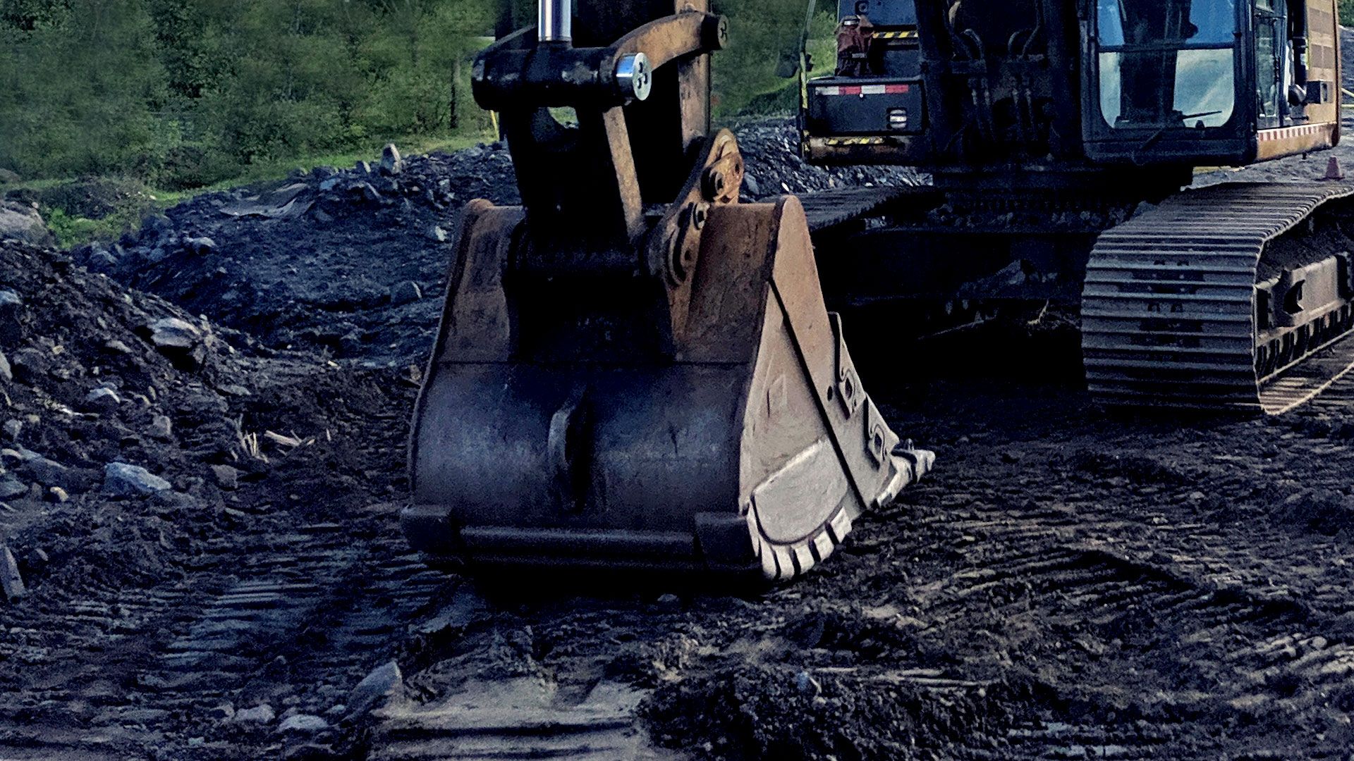 Hand Holding Brake Release Remote, underground scoop in the background