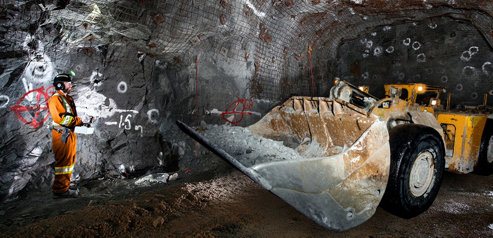 An operator is controling an LHD in an underground mineshaft using RRC